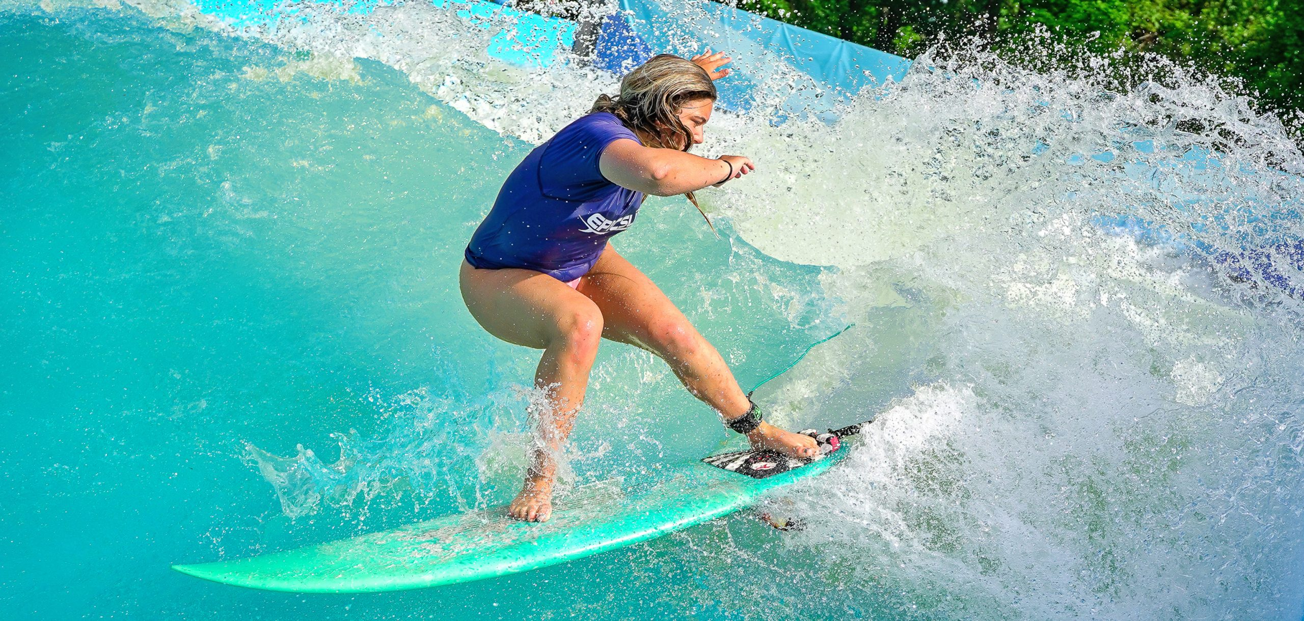 girl carving on epicsurf deep water surf wave